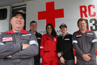 Red Cross team leader David Russell (left) with team members (from left) Mike Carson, Pam Hiroti, Paulette Archer, and Shaun Jarman outside the Red Cross truck. Photo/ Stuart Munro