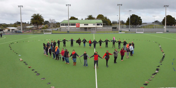 Supporters of Kaikohe's contribution to National Suicide Awareness Day form a heart inside a heart of shoes representing those who took their own lives in the last year. Photo / Debbie Beadle
