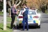 INVESTIGATING: Detective Sergeant John McCarthy, left, and Constable Andrew Chantrey investigate the aggravated robbery in Outram Rd, Hastings. PHOTO/DUNCAN BROWN