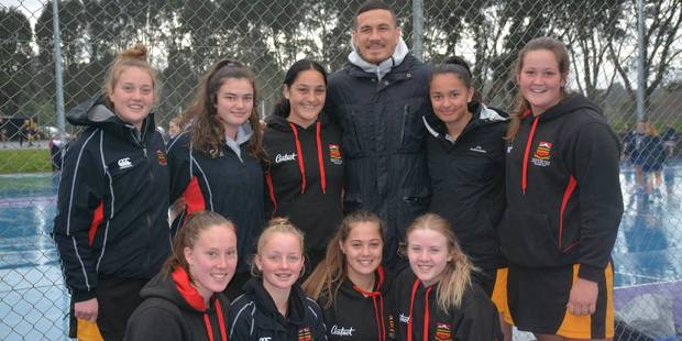 Stratford High School netball players pose found Sonny Bill Williams in the crowd at a recent netball tournament.