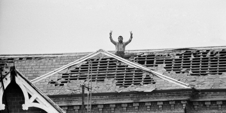 Michael Peterson (aka Charles Bronson) stages a protest on the roof of Broadmoor Hospital. 20th June 1983. Photo / Getty