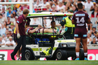 Jake Trbojevic of the Sea Eagles is carried off the field after taking a big hit from Konrad Hurrell during the 2016 NRL Nines. Photosport