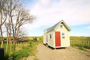 The tiny house sits on 4 acres of land. Photo / Youtube / Living in a big tiny house