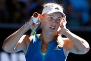 Denmark's Caroline Wozniacki reacts while playing Britain's Johanna Konta. Photo / AP