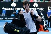 Britain's Andy Murray carries his bags from the court following his fourth round loss to Germany's Mischa Zverev. Photo / AP