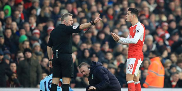 Arsenal's Granit Xhaka, right, was sent off in his side's win over Burnley. Photo / AP