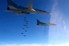 In this photo provided by the Russian Defence Ministry Press Service shows Russian air force Tu-22M3 bombers strike Isis targets in Syria today. Photo / AP