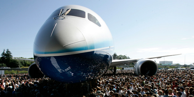 Visitors crowd around the first production model of a new Boeing 787 Dreamliner airplane. Photo / AP