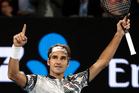 Switzerland's Roger Federer celebrates after defeating compatriot Stan Wawrinka during their semifinal at the Australian Open. Photo / AP