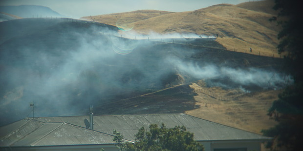 Loading A fire north of Puketapu Rd in Hawke's Bay, which has blackened dry paddocks near houses, is just one of many fires in today's dry and windy conditions. Photo/Simon Forbes