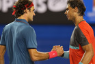 Rafael Nadal of Spain shakes hands with Roger Federer of Switzerland after Nadal won their semifinal match during day 12 of the 2014 Australian Open. Photo / Getty Images.
