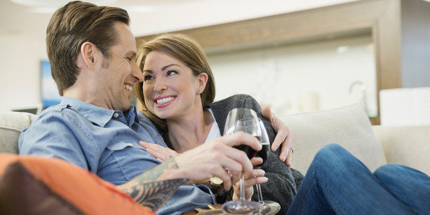 The scientists suggest being married to someone who opens a bottle of wine every night makes heavy drinking seem more normal and appealing. Photo / Getty Images