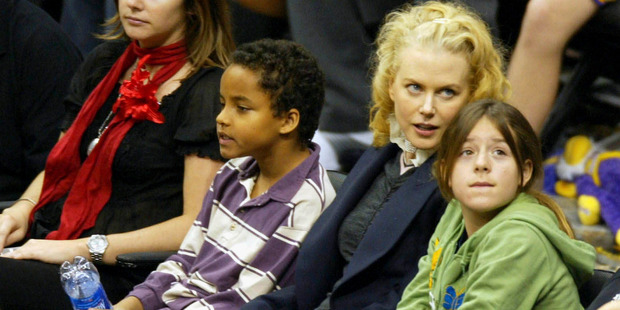 Nicole Kidman and her oldest children Connor and Isabella at a basketball game in 2004. Photo / Getty