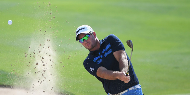Ryan Fox plays from a bunker during the Abu Dhabi HSBC Championship. Photo / Getty Images