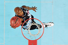 Kevin Dillard lays in the ball during the Breakers' clash with Perth at Vector Arena. Photo / Getty