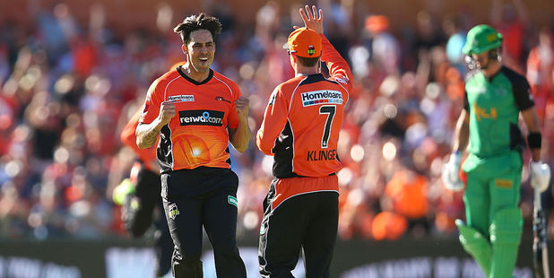 Mitchell Johnson and Michael Klinger of the Scorchers celebrate the wicket of Kevin Pietersen of the Stars. Photo / Getty Images
