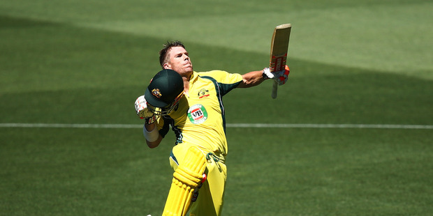 David Warner of Australia celebrates after reaching his hundred against Pakistan. Photo / Getty