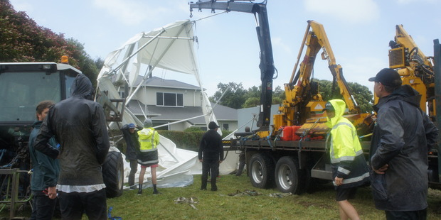 Loading Wild weather has destroyed a South Taranaki couple's wedding marquee. Photo / Supplied
