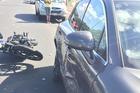 Cadena Silva's Harley-Davidson alongside Buchanan's Porsche, both were damaged in the crash. Photo / Supplied