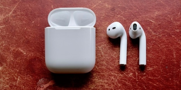 Apple AirPods with the charging case. Photo / Juha Saarinen