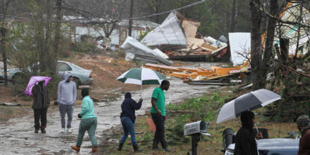 Residents in Mississippi wander through their neighbourhood after their homes were damaged by a tornado. Photo / AP