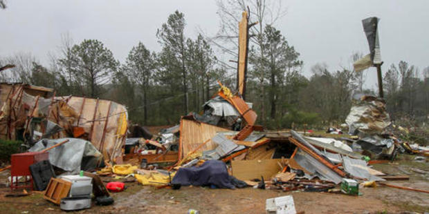 Loading Parts of mobile homes and other property lay strewn throughout a neighbourhood in Mississippi after a tornado passed through the area late Saturday. Photo / AP