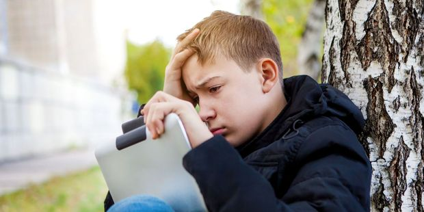 Children were having to deal with technology and social media earlier. File photo / 123RF