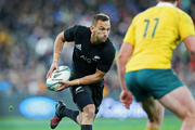 All Black first-five Aaron Cruden looks to offload against Australia. Photo/Photosport