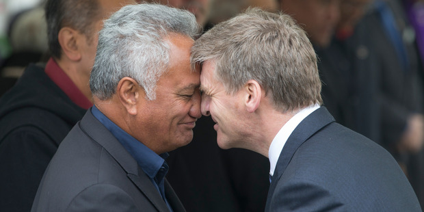 Loading Prime Minister Bill English hongis with former Labour MP Mita Ririnui, at the Ratana Pa Marae. Photo / Mark Mitchell