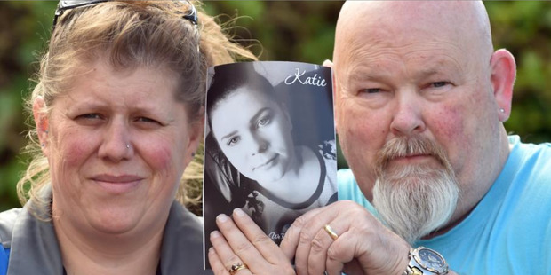 Susie and Bill Burt hold a photograph of their daughter Katie. Picture / Otago Daily Times