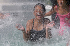 Nikala Vaafusu plays in the fountain at Mission Bay yesterday. Photo / Chris Loufte