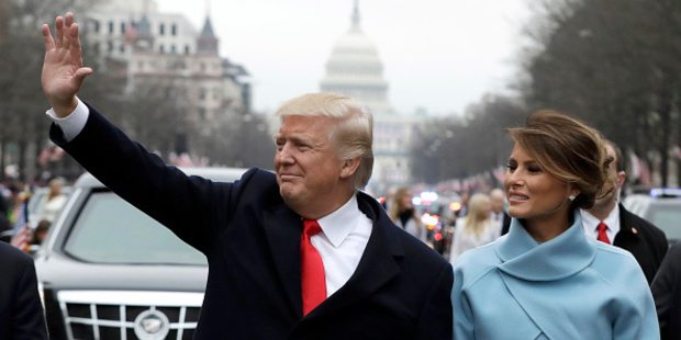 Donald Trump waves to supporters as he walks the parade route with first lady Melania Trump. Photo / Getty Images