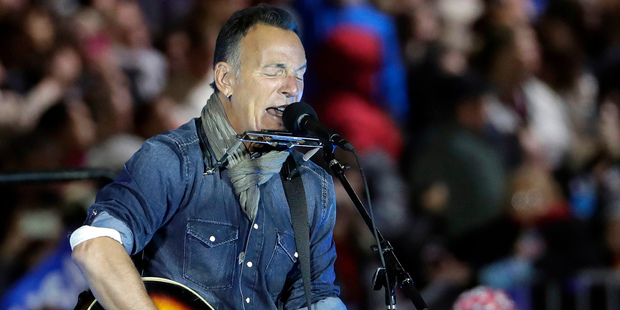 Bruce Springsteen performs during a Hillary Clinton campaign. Photo / Matt Slocum/AP