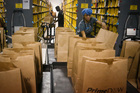 Amazon is poised to shake up Australia's $315 billion retail industry when it sets up shop Down Under. Photo / AP