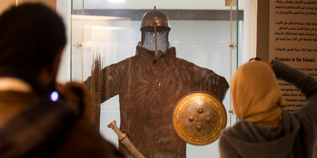 Visitors view a warrior costume, helmet and quiver dated to the 15th-16th century Mamluk period, during the re-opening of the Museum of Islamic Art in Cairo. Photo / AP
