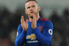 Manchester United's Wayne Rooney waves to fans after the English Premier League soccer match between Stoke City and Manchester United. Photo / AP.
