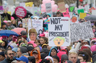 A crowd listens to speakers a rally before a women's march during the first full day of Donald Trump's presidency in San Francisco. Photo / AP