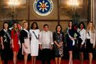 Philippine President Rodrigo Duterte, center, and Philippine Tourism Secretary Wanda Teo, fourth right, pose with Miss Universe contestants. Photo / AP