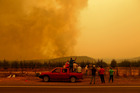 Locals have been battling the fires without any protective gear and often using just branches or bottles of water. Photo / AP