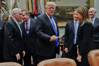 Chris Liddell, far right, was with Donald Trump when he met GM CEO Mary Barra this week. Photo / AP