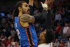 Steven Adams shoots over Buddy Hield during the Thunder's win over the Pelicans. Photo / AP