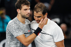 Spain's Rafael Nadal, right, is congratulated by Bulgaria's Grigor Dimitrov after winning their semifinal at the Australian Open tennis championships. Photo / AP.