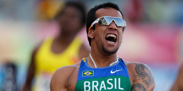 Brazil's Bruno De Barros celebrates, after crossing the finish line to win the men's 4x100m relay at the Pan American Games. Photo/AP Photos