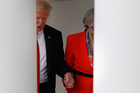 Trump and May were spotted holding hands at one point as they walked around the White House grounds. Photo / AP