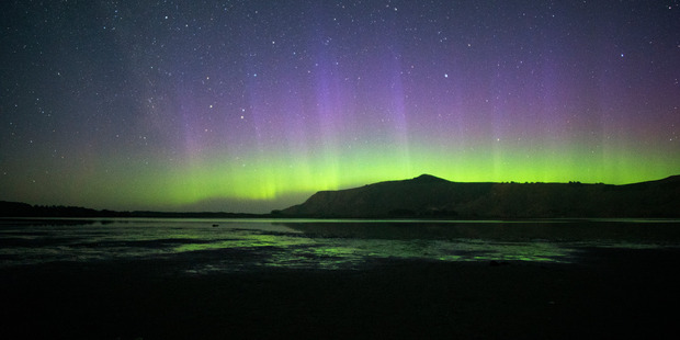 The Aurora Australis taken from Hoopers Inlet on the Otago Peninsula. Photo / Ian Griffin