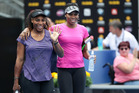 Venus (left) and Serena Williams have dominated tennis in a way no other siblings have managed in any other sport. Photo / Doug Sherring