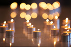 Candles lit by transplant recipients  during a remembrance service for organ donors at St Paul's Cathedral in Wellington during 2015. Photo / File