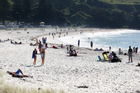 Busy day at Mount Maunganui beach, 2012. Photo / Mark McKeown