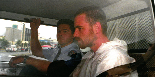 Stephen Anderson is driven from the Hamilton District Court after he was charged with murder and attempted murder. Photograph New Zealand Herald.