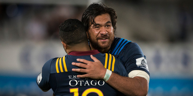 Blues no.8 Steven Luatua embraces Highlanders 1st5 Lima Sopoaga after the opening match of Super Rugby season in 2016. Photo / Jason Oxenham.